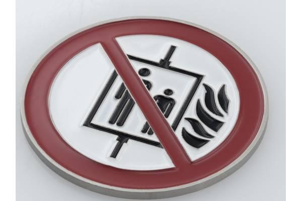"""Piktogramm: """"Aufzug im Brandfall nicht benutzen!"""" (weiß)"""